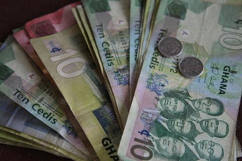 Des billets et pièces du Ghana Cedis